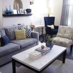 Grey, yellow and blue west elm. Blue is lovely but I say purple!