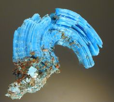 These fibrous crystals of Chalcanthite formed by seepage of ground water through copper bearing minerals and then evaporation of the water in the dry environment of a mine in Arizona.