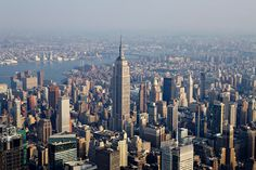 Description of  Office and residential buildings stand around the Empire State Building in midtown Manhattan in this aerial photograph taken over New York, U.S., on Wednesday, July 7, 2010. Photographer: Daniel Acker/Bloomberg