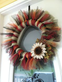 Candice Craves: Making a Tulle Wreath (fun noodle duct-taped, wrap noodle with ribbon/fabric before tulling) -- use different accent piece. in different colors and no flower! Fall Tulle Wreath, Fall Wreaths, Mesh Wreaths, Christmas Wreaths, Tutu Wreath, Floral Wreaths, Prim Christmas, Burlap Wreaths, Summer Wreath