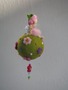 Needle felted spring mobile with waldorf inspired little fairy. The fairy is sitting on a top of the green felted ball, the ball is decorated with