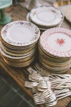 Mismatched dessert plates and silverplate forks collected from flea markets. For a party, buffet or 'cake & punch' wedding reception.
