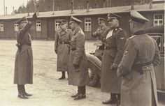 RetrieveAsset.aspx (800×518) Reichsführer-SS Heinrich Himmler (center) is saluted upon his arrival in Dachau. Among those pictured is Jochen Peiper (background), Karl Wolff (fourth from left) and Oswald Pohl (2nd from the right).