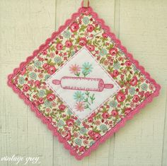 Inspiration Pic- Like the design. This was done from a repurposed vintage linen. My potholders are well-used so I think I would use new materials but love the styling.