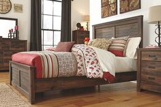 Quinden Queen Panel Bed by Ashley HomeStore, Brown