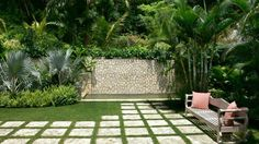 Comfortable Stepping Stones for Patio on Bianco Ibiza Marble Look also Teak Wood Garden Benches n Top of Zoysia Manila Lawn Grass and Small Square Fish Pond