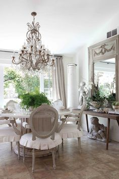 gray chair and neutral slipcovers