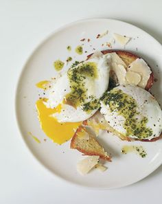 Poached eggs and parmesan cheese over brioche with pistou
