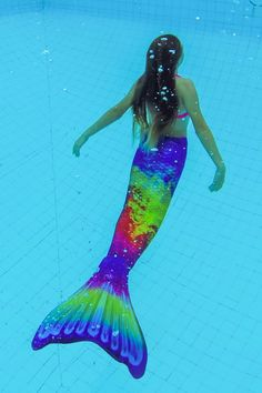 Shop Fin Fun's exotic, rainbow-colored mermaid tail in vibrant hues for an unforgettable swim! Mermaid Tail Drawing, Fin Fun Mermaid Tails, Mermaid Swim Tail, Mermaid Scales, Bold Colors, All The Colors, Disney Furniture, Jellyfish Art, Amazon Rainforest