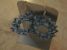 orecchini in chiacchierino rivestito su di un anello