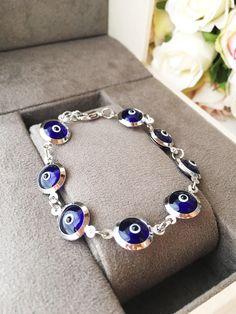 """https://www.etsy.com/listing/553056697/evil-eye-bracelet-link-chain-evil-eye Evil eye bracelet, link chain evil eye bracelet, blue evil eye beads, evil eye chain bracelet, blue evil eye bracelet, silver bracelet Beads size: 12mm Lenght of chain: 8.2"""" (21 cm) #evileye #evileyes #evileyebracelet #silverbracelet #blueevileye #bluebracelet #chainbracelet #chainlinkbracelet"""