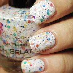 Paint-splatter chunky nail polish! I normally am not a fan of this type of polish, but I love the rainbow against the white
