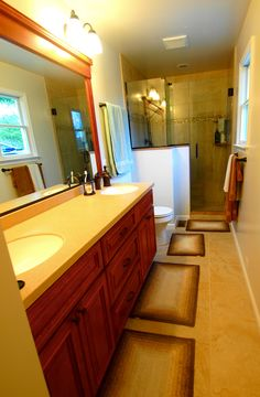 Master bathroom renovation with double vanity and tile shower with frameless shower enclosure. Frameless Shower Enclosures, Bathroom Renovations, Corner Bathtub, Double Vanity, Master Bathroom, Tile, Mosaics, Corner Tub, Tiles