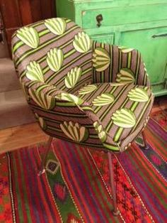 I have a lot of African wax fabric that I want to use to recover a modern chair someday.