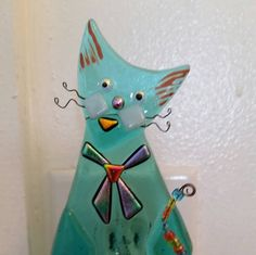 Check out this item in my Etsy shop https://www.etsy.com/listing/255821014/whimsical-cat-fused-glass-night-light