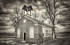 photo by Scott Norris.  At first, I thought this was an old church. Especially because of the religious themed graffiti on the inside. But the sign above the door says Dis. No. 5 1871. This is between German Valley and Ridott, Illinois.