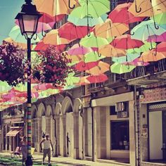 Agueda, Portugal........I really like umbrellas for decorating