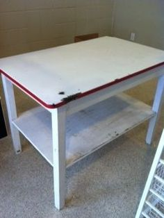 Enamel Top Hoosier Style Table With Shelf Beneath Great Island In A Vintage Kitchen