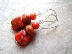 This listing is for a pair of dyed jasper earrings in a vibrant orange. A top of the orange jasper beads is an orange freshwater pearl. The earwires are silver filled (sterling silver bonded to white brass) and fashioned by me. Earrings are 2 inches. Shop Sale, Spring Sale, Silver Spring, Jasper, Silver Earrings, Mothers, Orange, Fruit, Unique Jewelry