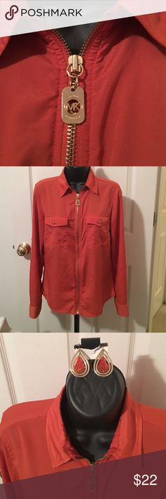 Michael Kors zip blouse Orange Michael Kors zip blouse. Can wear sleeves long or rolled   Detailed mk buttons and zipper pull. Only worn 3x EUC. Paired with pair of gold and orange earrings (not mk). Pet free smoke free home Michael Kors Tops Blouses