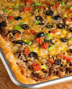 Taco Pizza, you can make this healthy by using ground turkey and all fresh veggies.