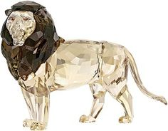 2016 Akili Lion SCS Annual Edition  2016 Akili Lion SCS Annual Edition Proud,bold and Beautiful Lion Akili, crystal body with a light sand coating and a contrasting smokey Quartz mane, He has light smoked topaz eyes and 941 facets. This piece is the Annual Edition Member only piece for 2016, one per member and proof of membership required to purchase.