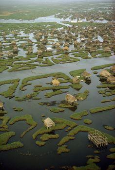 Many stilt houses of Dahomey village are scattered across lagoon. Ganvie, Benin