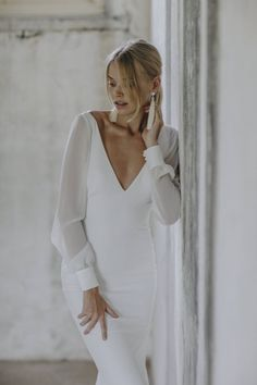 Modern and elegant wedding gowns from Made with Love Bridal via Magnolia Rouge