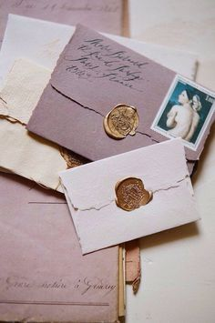 A Girl Inspired, pink and mauve wedding invitations with a gold wax seal and beautiful stamp