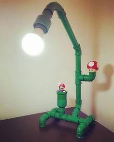 Learn how to make a table lamp with the Mario Bros theme .- Aprendar a fazer uma luminária de mesa com o tema mario bros. More on good idea… – Learn how to make a table lamp with the Mario Bros theme. More on good idea … - Mario Bros, Mario Brothers, Pvc Pipe Projects, Make A Table, Geek Decor, Gamer Room, Pipe Lamp, Diy Furniture, Repurposed Furniture
