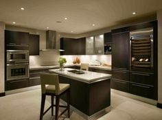 I like the combo of the dark cabinets and light floors and countertops
