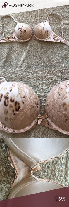 Victoria's Secret tan/cheetah print lace bombshell Beautiful tan/cheetah print lace bombshell bra! Adds two sizes and is in great shape. Only the slightest pilling, see third pic.   🌙If it is listed it is available ⭐️No trades ☀️No PayPal Victoria's Secret Intimates & Sleepwear Bras