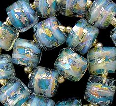 DSG Beads Handmade Organic Lampwork Glass Made To Order (Teal Opals), via Etsy.  How I love these.