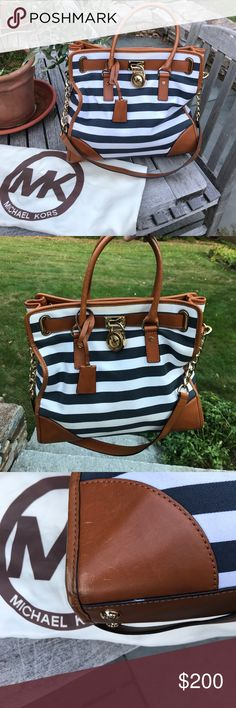 Michael Kors striped Hamilton tote Michael Kors navy and white striped Hamilton tote with shoulder strap and dust bag. Minor wear and tear (photographed) around leather edges and around the lock detail. Michael Kors Bags Totes