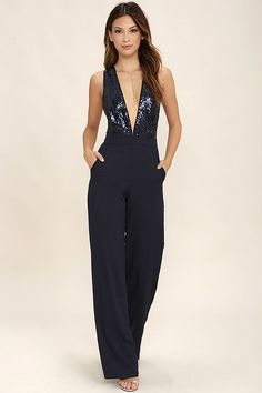 All eyes will be on you when you enter the dance floor in the Disco Heaven Navy Blue Sequin Jumpsuit! A plunging, knit bodice (with crisscrossing back straps) is covered in glittering sequins. Tying waist sash and side seam pockets top the wide, woven pant legs. Hidden back zipper/clasp.