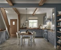 This framed Shaker style door with wood grain effect, in an on-trend shade of grey, will suit both modern and traditional settings. Visit our website to find out more about the NEW Tewkesbury Slate Grey kitchen range. Howdens Kitchens, Grey Kitchens, Fitted Kitchens, Kitchen Views, Kitchen Units, Kitchen Paint, New Kitchen, Grey Shaker Kitchen, Kitchen Walls