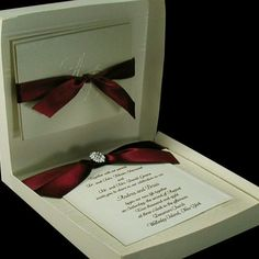 Boxed couture wedding invites in red