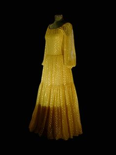 Queen Silvia's dress from the 1976 Nobel Prize Award Ceremony.    Gold sequins mak this evening gown of yellow chiffon, designed by Dior