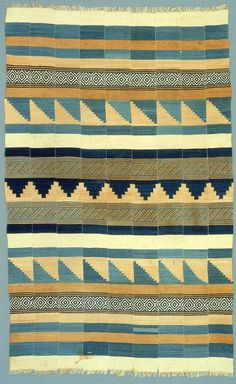 Africa | Blanket. Mende peoples.  Sierra Leone, Yengama | Early 20th century | Cotton, indigo dye, kola nut dye | example of West African narrow-strip weaving. Nine identically patterned strips, each about five inches wide, are joined to form bands of pattern across the width of the fabric. The textile was woven with two different techniques, a plain weave with twill patterns and a tapestry weave.