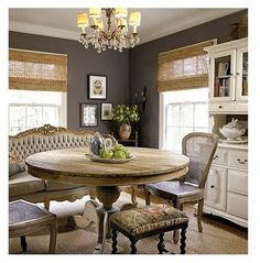 Wall color, natural wood of table, mix-matched chairs.... perfection!