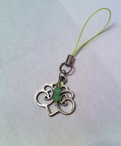 Filigree charm with mint green crystals cell by BeadingByJenn, $8.50 #cellphonecharm #phonecharm #phone #mintgreen #keychain #pursepull