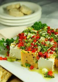 Colorful ... beautiful ... absolutely delicious ... and always the hit of the party. This Marinated Cheese may just be the most perfect p...