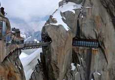 journey into the high mountain landscape surrounding the Aiguille du Midi can be made by the Panoramic Mont Blanc lift which is the highest cable car traverse in the world and which connects France and Italy. Above is the viewing platform and bridge suspended 3842m above sea level.