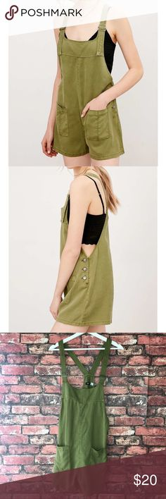 BDG Nicki Overall Romper The perfect lightly distressed olive green overalls for the spring and summer time. Great for festivals or causal sunny days out with family or friends. In excellent condition.  Length 24in (Measured from Chest) Width 18.5in Urban Outfitters Other