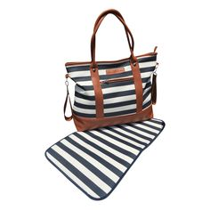 "Navy stripe canvas diaper bag by Mama Martina. Oversized, practical and trendy diaper bag made from durable materials. Includes adjustable cross-body strap, stroller straps and matching changing pad. 17 x 15x 5""."