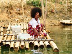 Orang Asli women washing at Royal Belum National Park Malaysia