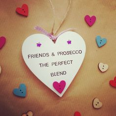 Bespoke Heart Hanging Plaques with the quote Friends & Prosecco, The Perfect Blend. These Handmade plaques are 10cm x 10cm (widest point) in