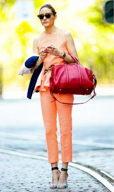 Olivia Palermo having a matching moment in a bright orange top and bright orange bottoms