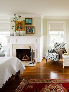 Living room; like colors, grouping of 3 frames above mantel