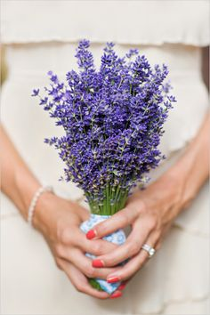 lavender bridesmaid bouquet- like the idea of small vase, so they can be easily added to reception decor after the ceremony!
